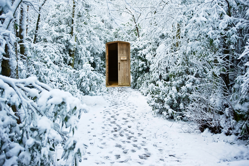 Door in snow landscape - surreal dream image