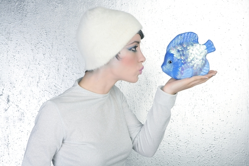 Woman holding fish surreal