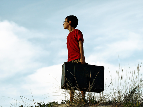 Boy Refugee with suitcase - Dream Symbol.