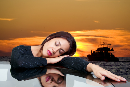 Sleeping woman with picture of dream ship. Dream Meaning for Woman Symbol.