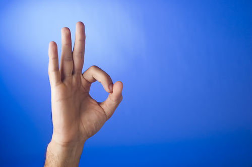 Hand showing Zero with fingers. Dream Symbol for Zero